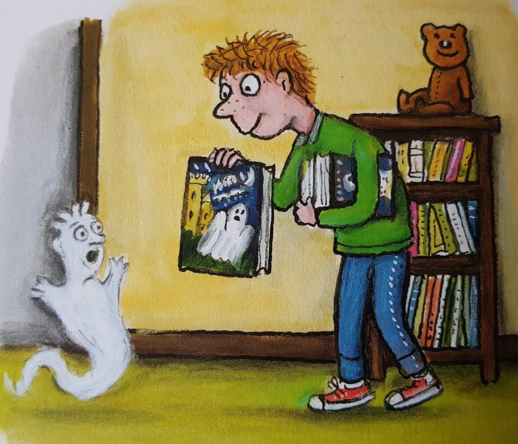 Paul zeigt Zippel ein Buch mit Gespenstergeschichten